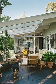 for this indoor outdoor living room green walls were used