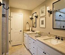 taupe beige bathroom with rubbed bronze fixtures hardware and espresso mirrors