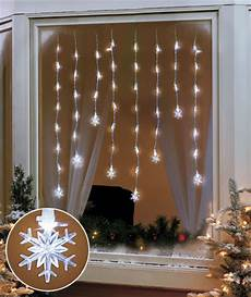 Lighted Decorations For Windows by Snowflake Led Window Hanging Icicle Lights Indoor Home