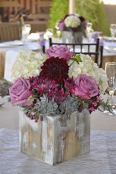 fall and rustic style centerpiece using lavender and plum colored flowers wedding flowers