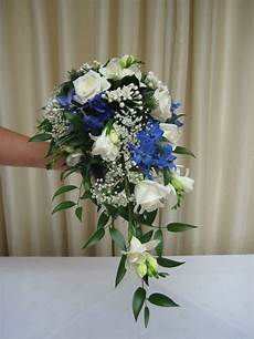 blue wedding flower bouquets white roses freesia