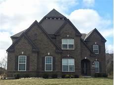 manor house tudor brick timberbark siding beige windows musket brown trim exterior brick