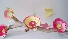 diy des fleurs en papier pastel pour un centre de table