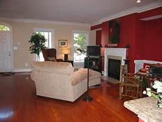 image painting sitting area fireplace red accent wall eclectic living room dc metro by