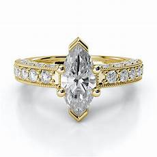 marquise diamond engagement ring with milgrain and side stones 18kt yellow gold