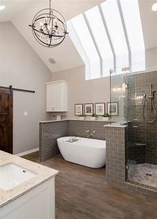 gray and white transitional spa bathroom with chandelier