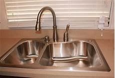 how to install a faucet in the kitchen how to install a delta kitchen faucet