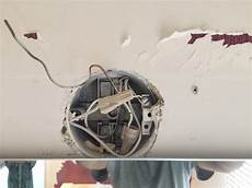 electrical how can i install a light fixture when the junction box is partially blocked by a