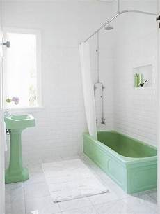 everything is new again green and white bathroom