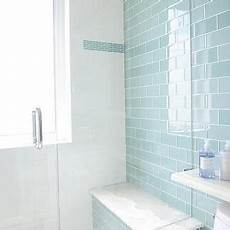 blue glass subway shower tiles with gray mosaic shower