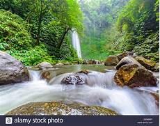 a large waterfall the beautiful tropical island of bali