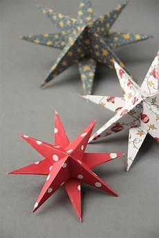 basteln weihnachten sterne diy 3d paper decorations gathering