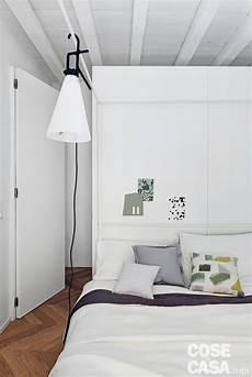 da letto arredata mini bilocale di 45 mq con travi a vista in bianco cose