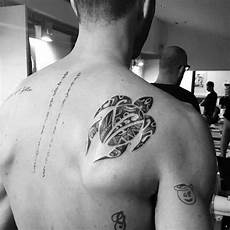 with swimming turtle on shoulder blade tribal tattoos