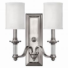 sconce wall light with beige shades in brushed