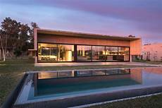 spectacular house surrounded by spectacular concrete house surrounded by fields and