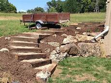 railroad tie timber steps filled with pea gravel outdoor
