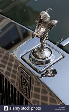 Emily Ornament Of A Rolls Royce Parked In Front Of