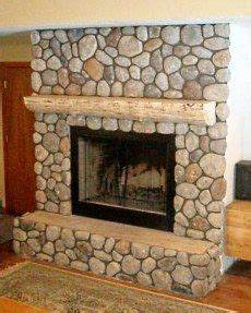river rock real burning fireplace with space for above mantle completed by brown