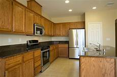 what color to paint kitchen with dark oak cabinets paint color advice for a kitchen with oak cabinets thriftyfun