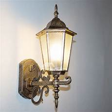 rustic wall sconce glass wrought iron outdoor
