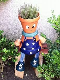 Un Jardinier En Pot De Terre Vasos Decorativos Vasos