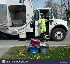 Garbage Collection by Garbage Collection With A Recycling Truck Collecting