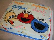 sesame street birthday 1 2 sheet cake with big bird elmo and cookie monster drawings