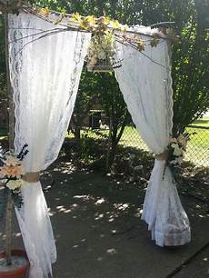wedding arch i made for daughters wedding repurposed curtains downed tree limbs dollar tree