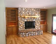working with the river rock paint the built in s grey love this with the book shelves