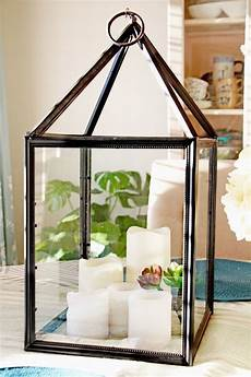 diy farmhouse lantern made from the dollar store supplies