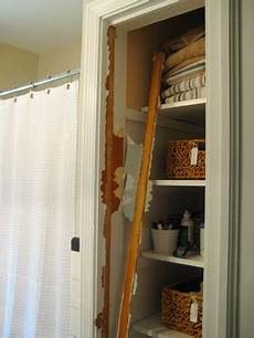 bathroom closet door ideas take the door your bathroom linen closet for a chic and open feeling