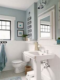 white panelling to make light blue bathroom more airy
