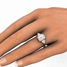 emerald cut morganite ring with trillion white sapphire side stones rare earth jewelry