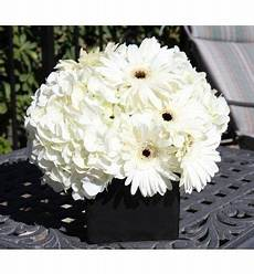 white gerber centerpiece with images spring