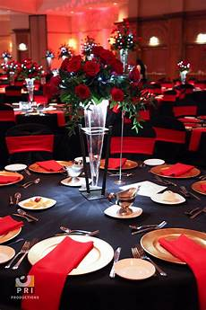 black tie motown event with classic red rose centerpiece and red black table linens