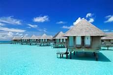 美丽的海滩茅草屋景色高清图片 素材中国16素材网