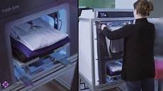 la machine tr 232 s pratique qui repasse et plie le linge en