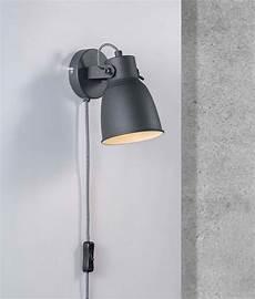 light or dark grey industrial wall light with plug lead