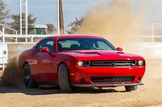 dodge challenger driving a 2015 dodge challenger hellcat in a snowstorm
