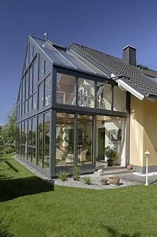 einfamilienhaus zweistoeckiger wintergarten mit zweigeschossigen wintergarten mit galerie bei hof
