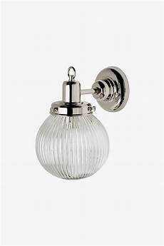 discover wall mounted single arm sconce with glass shade online waterworks bathroom