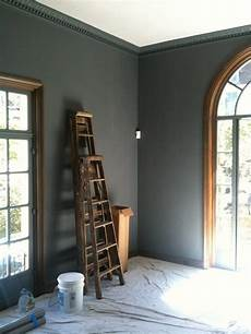 crown molding painted the same color as the walls make the ceilings taller while adding