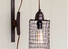 industrial modern edison cage and pulley plug in wall sconce woodwaves