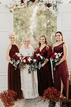Cranberry Hued Winter Wedding With A Spectacular Ceremony Backdrop