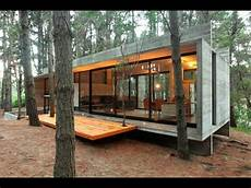 bloc cabine modern cabins casa cher concrete glass and pine trees