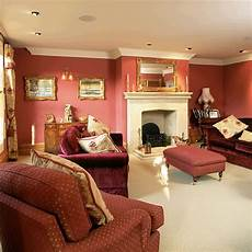 living room with red walls and sofas housetohome co uk