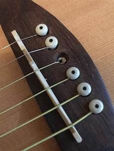 maintenance how do i fix a broken bridge pin without going to the guitar shop