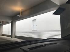 r watson garage on a building next to the third floor of a parking garage