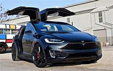 tesla model y doors how tesla s falcon wing doors work explained through lego